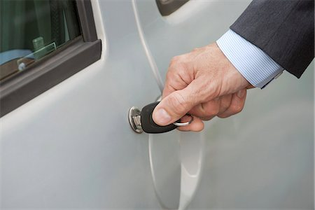 Man unlocking car door with key, cropped Stock Photo - Premium Royalty-Free, Code: 632-08227542