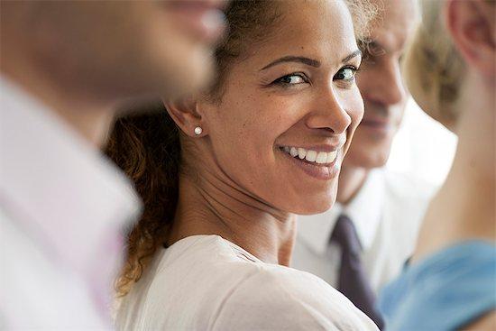 Businesswoman smiling over shoulder, portrait Stock Photo - Premium Royalty-Free, Image code: 632-08227676