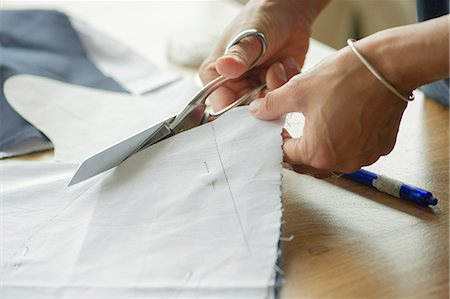 Woman cutting fabric, cropped Stock Photo - Premium Royalty-Free, Code: 632-08227695