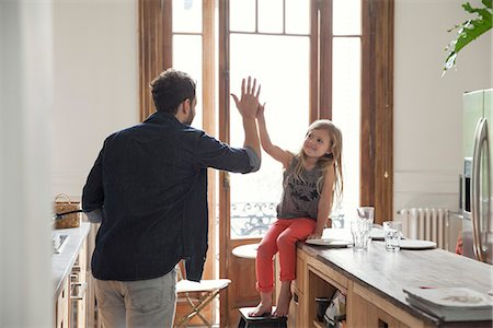 Father and daugther high-five Stock Photo - Premium Royalty-Free, Code: 632-08227843