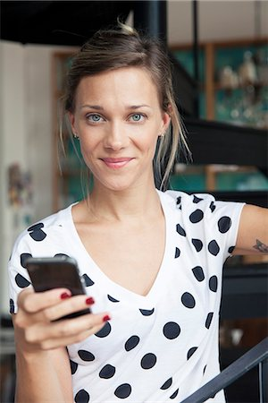 polka dot - Woman using smartphone Stock Photo - Premium Royalty-Free, Code: 632-08331410