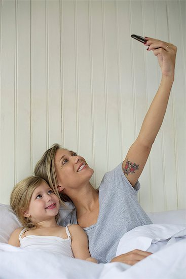 Mother and daughter posing for selfie Stock Photo - Premium Royalty-Free, Image code: 632-08331601