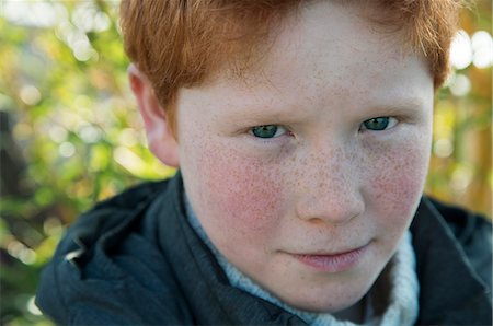 Boy with red hair and freckles, portrait Stock Photo - Premium Royalty-Free, Code: 632-08545948