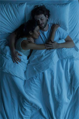 Couple asleep embracing Stock Photo - Premium Royalty-Free, Code: 632-08698342
