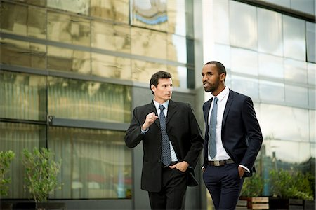 Businessmen walking and talking together Stock Photo - Premium Royalty-Free, Code: 632-08698428