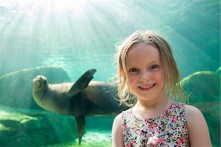 Little girl at aquarium, portrait Stock Photo - Premium Royalty-Free, Code: 632-08698475