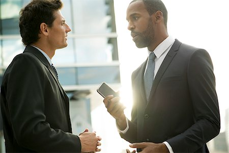Businessmen talking outdoors Stock Photo - Premium Royalty-Free, Code: 632-08698550