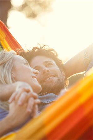 Couple relaxing together in hammock Stock Photo - Premium Royalty-Free, Code: 632-08698568