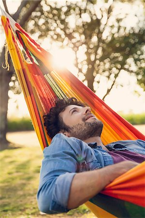 Man relaxing in hammock Stock Photo - Premium Royalty-Free, Code: 632-08698572