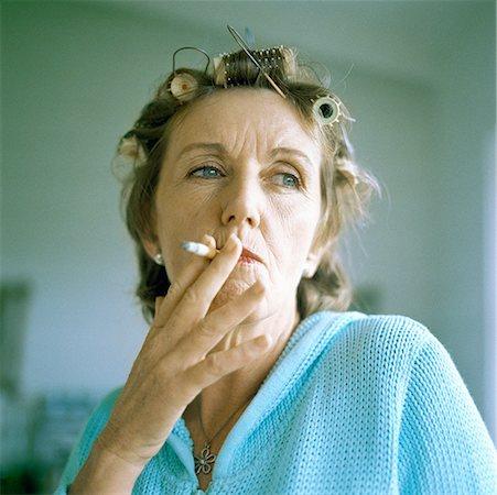 Mature woman smoking cigarette, portrait Stock Photo - Premium Royalty-Free, Code: 632-01144275