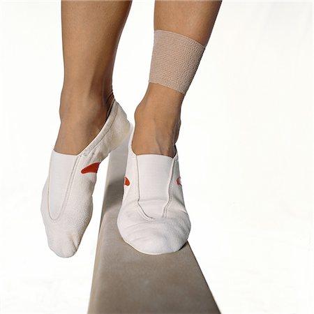 feet gymnast - Female gymnast's feet balancing on balance beam, close-up Stock Photo - Premium Royalty-Free, Code: 632-01144981