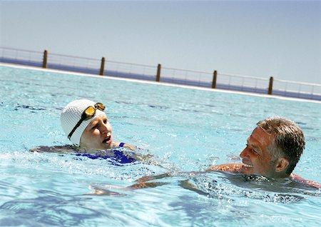 seniors and swim cap - Mature man and woman in swimming pool Stock Photo - Premium Royalty-Free, Code: 632-01146635