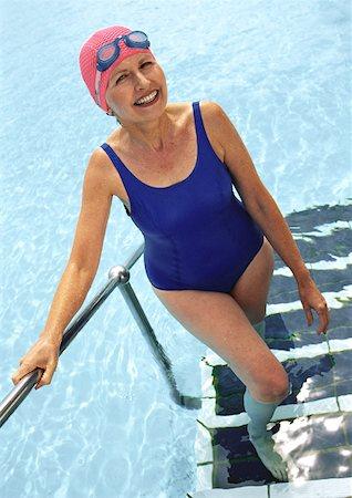 seniors and swim cap - Mature woman coming out of swimming pool, smiling Stock Photo - Premium Royalty-Free, Code: 632-01146645