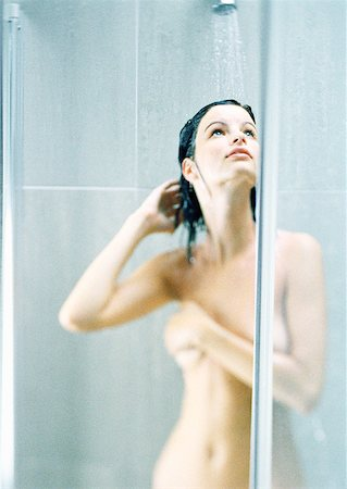 Woman taking shower, covering breast Stock Photo - Premium Royalty-Free, Code: 632-01148793