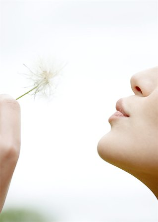 Woman blowing dandelion, close-up Stock Photo - Premium Royalty-Free, Code: 632-01154614