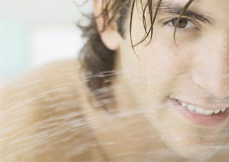 Man's face behind water spray Stock Photo - Premium Royalty-Free, Code: 632-01154750