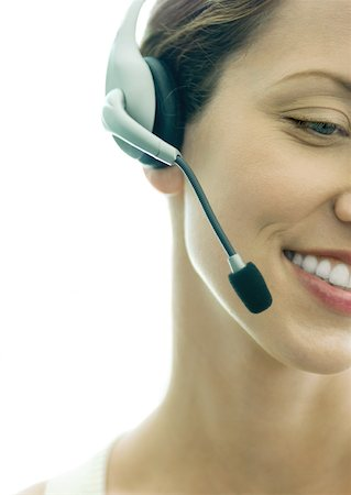 Woman wearing headset, cropped Stock Photo - Premium Royalty-Free, Code: 632-01155724