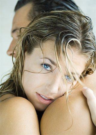 Woman embracing man, looking at camera Stock Photo - Premium Royalty-Free, Code: 632-01156294