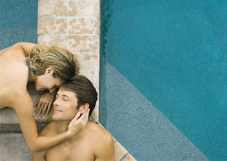 Couple lying by edge of pool Stock Photo - Premium Royalty-Free, Code: 632-01156300