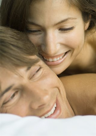 Couple in bed together, laughing, close-up of faces Stock Photo - Premium Royalty-Free, Code: 632-01156325