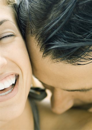 Man kissing woman's shoulder, woman laughing, close-up Stock Photo - Premium Royalty-Free, Code: 632-01156334