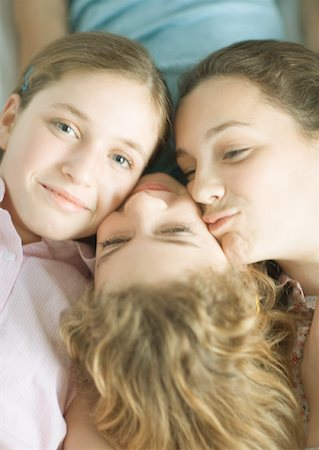 preteen kissing - Preteen girls with heads together Stock Photo - Premium Royalty-Free, Code: 632-01156698