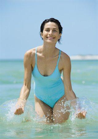 Woman splashing in water Stock Photo - Premium Royalty-Free, Code: 632-01156859