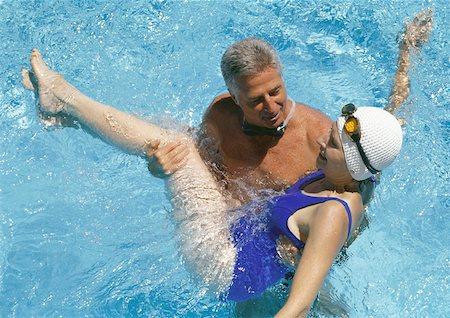 seniors and swim cap - Mature couple in pool Stock Photo - Premium Royalty-Free, Code: 632-01158577