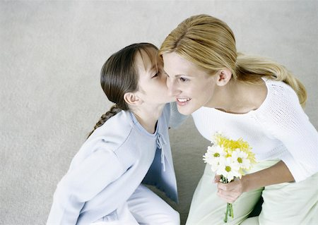 preteen kissing - Woman holding bouquet of flowers, girl kissing her cheek Stock Photo - Premium Royalty-Free, Code: 632-01151572