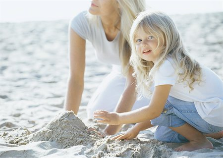 Girl and mother playing in sand Stock Photo - Premium Royalty-Free, Code: 632-01153630