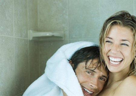 Couple drying off in shower together, laughing Stock Photo - Premium Royalty-Free, Code: 632-01161097