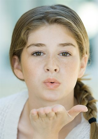 preteen kissing - Preteen girl blowing kiss Stock Photo - Premium Royalty-Free, Code: 632-01161574