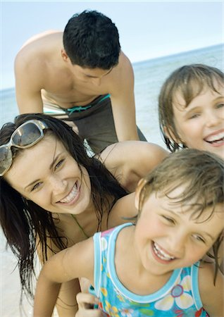 Family laughing on beach, close-up Stock Photo - Premium Royalty-Free, Code: 632-01270592