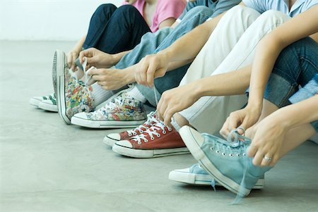 female 16 year old feet - Four teen friends tying laces, all wearing canvas shoes Stock Photo - Premium Royalty-Free, Code: 632-01379229