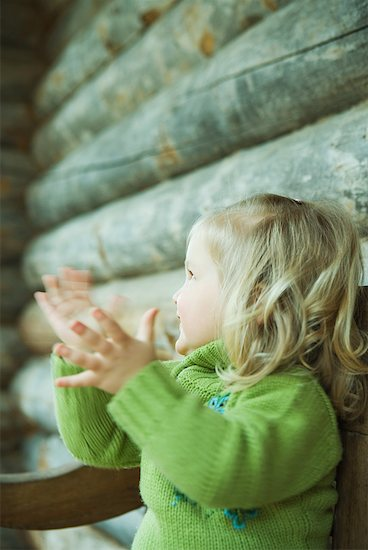 Toddler girl clapping hands, side view, blurred motion Stock Photo - Premium Royalty-Free, Image code: 632-01613189