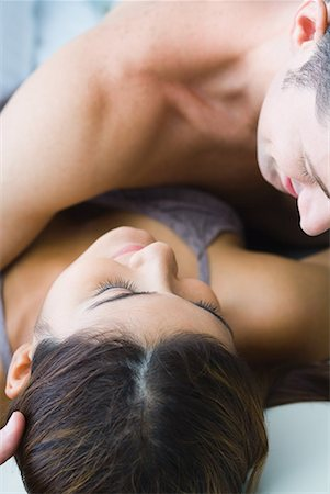 Man lying on top of woman, cropped view Stock Photo - Premium Royalty-Free, Code: 632-01638758