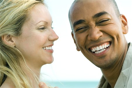 Couple laughing together, man looking at camera, close-up Stock Photo - Premium Royalty-Free, Code: 632-01827735