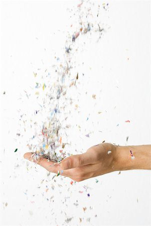 Hand catching falling confetti Stock Photo - Premium Royalty-Free, Code: 632-02128109