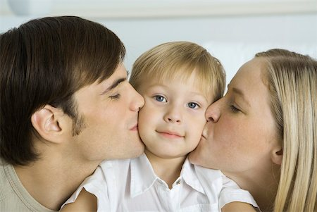 people kissing little boys - Parents kissing little boy's cheeks, boy smiling at camera Stock Photo - Premium Royalty-Free, Code: 632-02282919