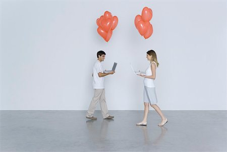 female silhouettes heart - Young man and woman walking toward each other, both carrying laptop computers and heart balloons Stock Photo - Premium Royalty-Free, Code: 632-02283016