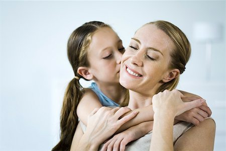 Mother and daughter embracing, girl kissing woman's cheek Stock Photo - Premium Royalty-Free, Code: 632-02416107