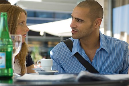 student fighting - Man and woman sitting in outdoor cafe, having serious conversation Stock Photo - Premium Royalty-Free, Code: 632-02644979