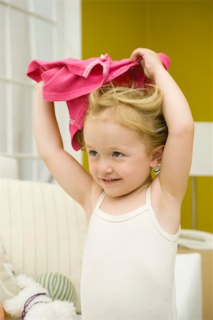 daily - Little girl holding shirt over her head Stock Photo - Premium Royalty-Free, Code: 632-02645137