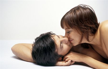 Couple lying together, kissing Stock Photo - Premium Royalty-Free, Code: 632-02689994