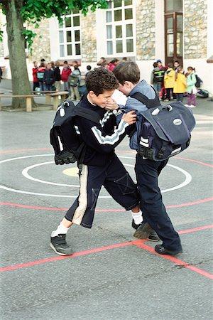student fighting - Boys fighting on school playground Stock Photo - Premium Royalty-Free, Code: 632-02690128