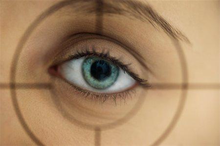 scope - Woman's eye behind gunsights Stock Photo - Premium Royalty-Free, Code: 632-02690228