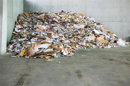 Paper and cardboard piled up in recycling center Stock Photo - Premium Royalty-Free, Code: 632-02690396