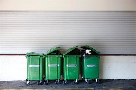 Overflowing garbage cans in a row Stock Photo - Premium Royalty-Free, Code: 632-02690393