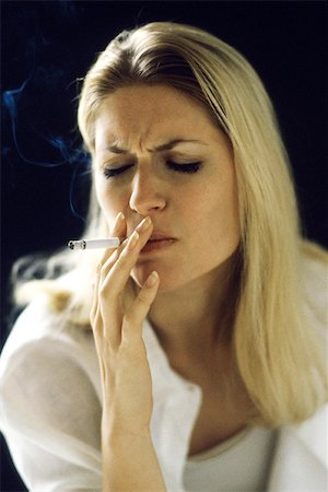 Woman smoking, eyes closed Stock Photo - Premium Royalty-Free, Code: 632-02744691