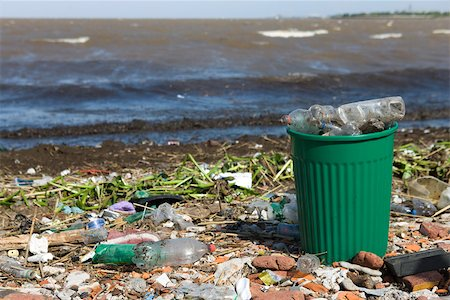 Garbage can overflowing with plastic bottles on polluted shore Stock Photo - Premium Royalty-Free, Code: 632-02745086